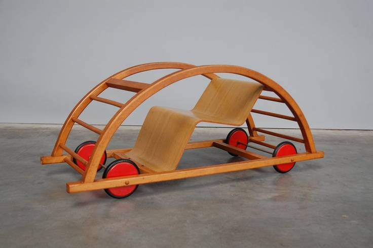 Kids toy car / that is also a rocking chair . Was designed by Hans Brockhage. 1950.