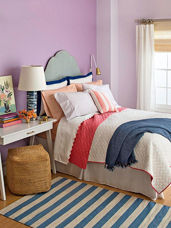 love this little bedroom | pops of coral + peach + lavender + navy over neutral base