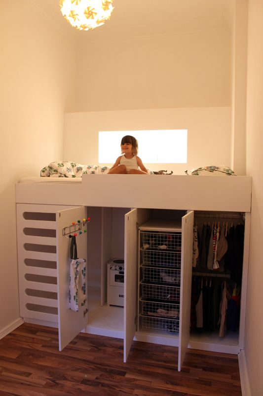 Loft bed with storage and closet space underneath.