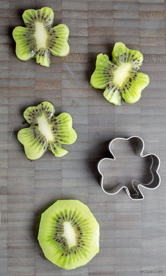 Use a shamrock cookie cutter on kiwi slices to make these adroable little kiwi shamrocks!
