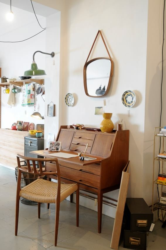 Scandinavian chair and desk/cupboard with leather strap mirror.