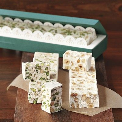 Italian Pistachio Torrone) Hazelnuts, almonds, honey, and spices in a ...