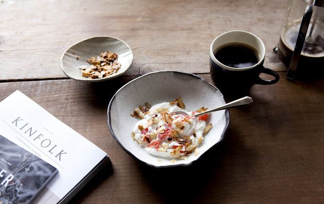 Greek yogurt, grapefruit, toasted almonds + unsweetened toasted coconut. coffee. #breakfast