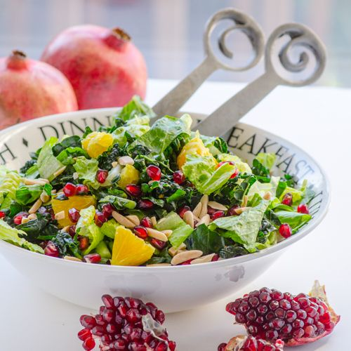 -- Raw kale salad with pomegranate arils, orange slices and toasted ...