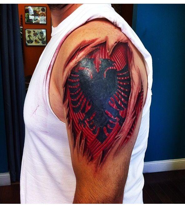 Albanian flag skin rip tattoo done by steve murzin at for Beauty mark tattoo