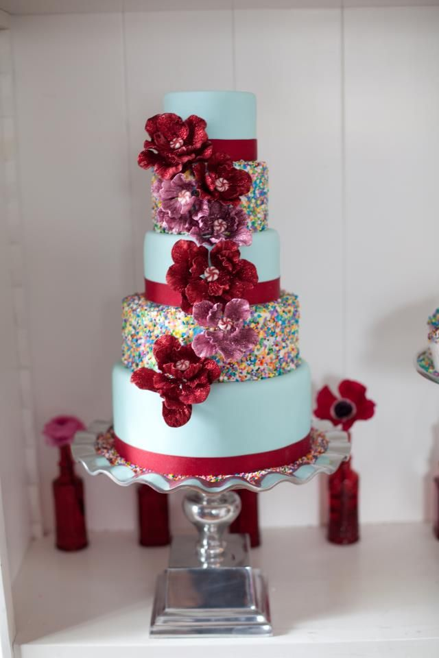 Whimsical Wedding Cake with Rainbow Sprinkles Red Blooms