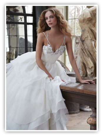 Available at StarDust Celebrations in Dallas, Texas. Feminine with an edge, Hayley Paige bridal gowns are fresh, lively and confident. Hayley Paige, head designer of the Blush and Hayley Paige bridal collections, made a jump start in fashion by interning at Elle magazine while attending Cornell University.