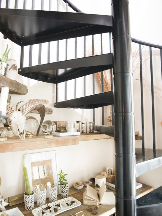 Step into an Artist's Airy Retreat // Spiral staircase and ram skull
