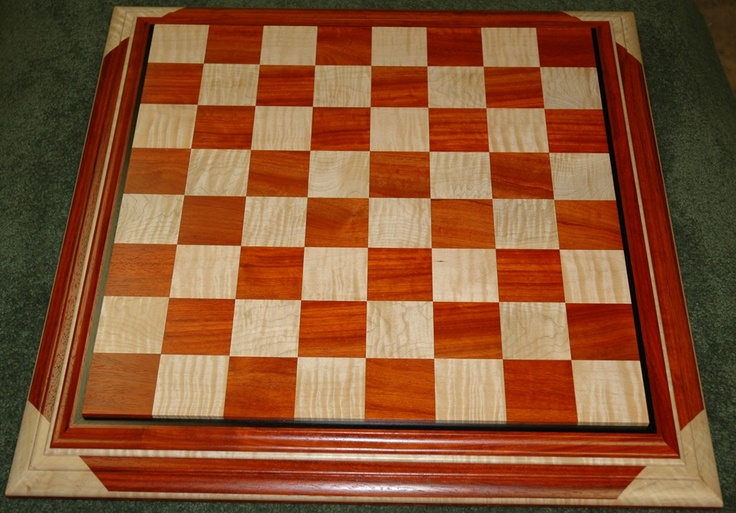 Custom Wood Creations Chess Boards by Joel Will.  Hand crafted chess boards made to order.  The best in the world if you're looking for something like this.  Tell him Jonathan the Chef from AZ sent you for a great price!
