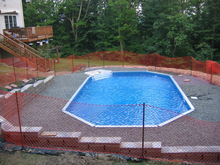 On ground pool on sloping yard pool pinterest for Pool design for sloped yard