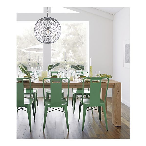 Green chairs, rustic wooden table, wood floor, and wire hanging lamp. by Crate and Barrel. via Emily Henderson.