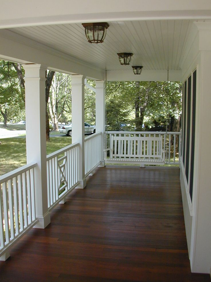 Dark stained porch white rails new house outside porch for Covered porch flooring options