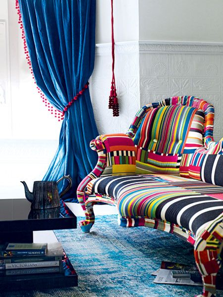 Give your living room a vibrant makeover with punchy, electric colors and eye-popping furniture. (Photo: Polly Wreford)