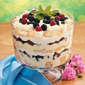 Ingredients    1-1/2 cups cold fat-free milk      1 package (1 ounce) sugar-free instant vanilla pudding mix      1 cup (8 ounces) fat-free vanilla yogurt      6 ounces reduced-fat cream cheese, cubed      1/2 cup reduced-fat sour cream      2 teaspoons vanilla extract      1 carton (12 ounces) frozen reduced-fat whipped topping, thawed, divided      1 prepared angel food cake (18 inches), cut into 1-inch cubes      1 pint each blackberries, raspberries and blueberries