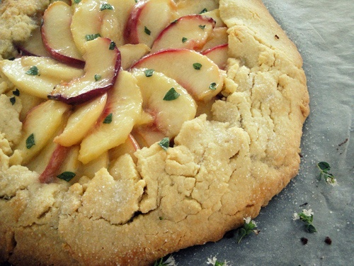 almond and peach galette with honey thyme glaze