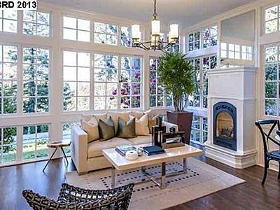 Gorgeous Sunroom With Fireplace
