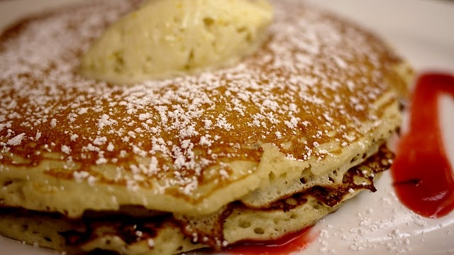 Fluffy pancakes with citrus cream and raspberry coulis...mmmm.