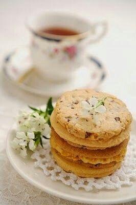 ... tea time a cup of tea and plate of orange coconut tea orange cookies