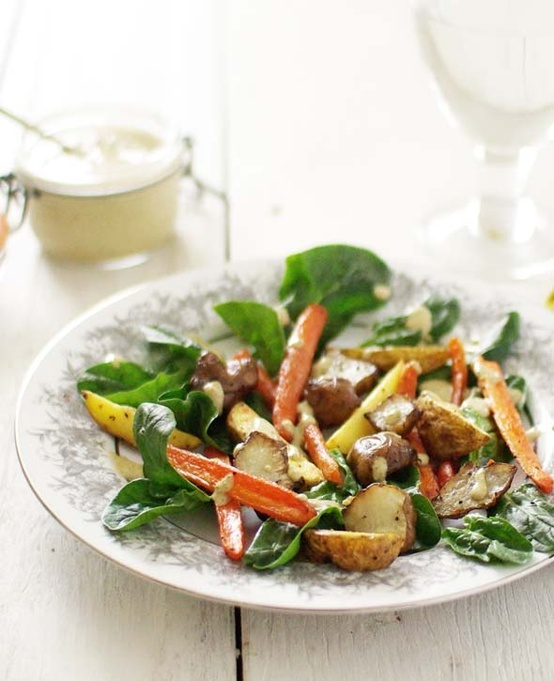 Roasted root vegetable and spinach salad with lemon-tahini dressing
