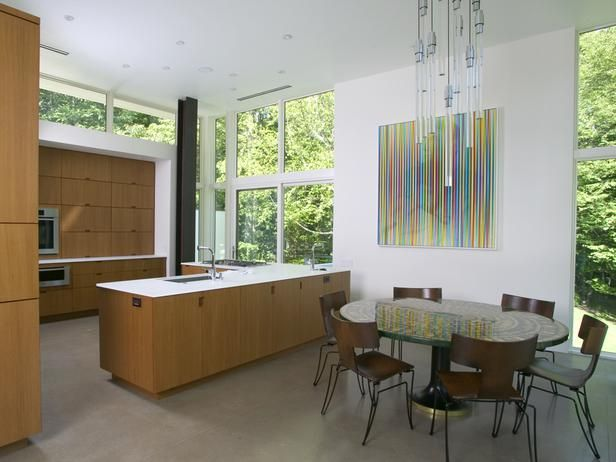 SPG Architects' Pawling House in Pawling, N.Y., features an open, loft-like living space with soaring ceilings. The open plan situates the dining room opposite the large kitchen. With warm woods, the kitchen is an inviting space in this clean and modern home. Photograph by Randy O'Rourke