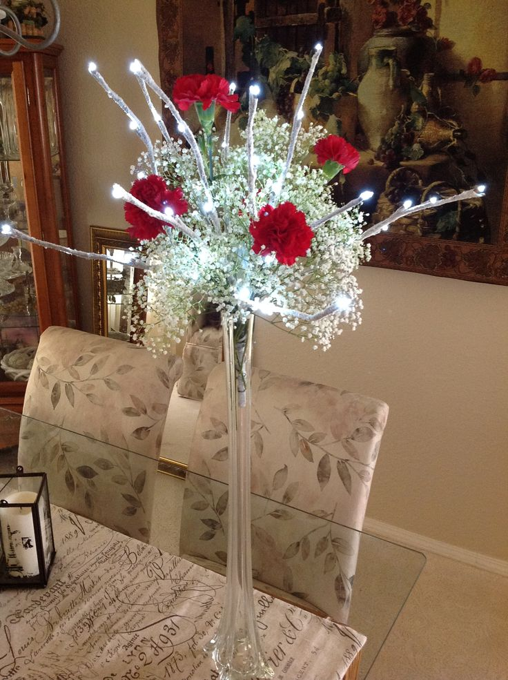 Lighted Branch Arrangements In Eiffel Tower Vases