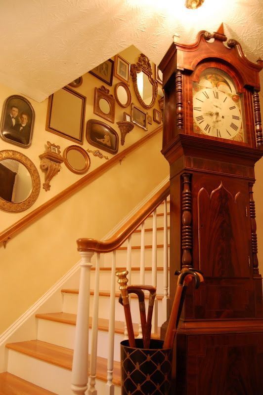 decorating staircase walls with vintage photos and mirrors