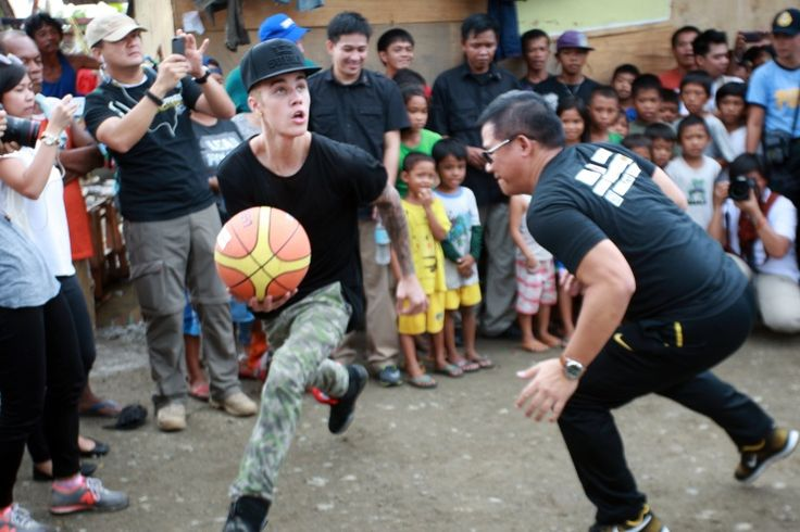 You can call him Air Bieber. Justin Bieber shows off his hoop skills during a visit in support of Typhoon Haiyan survivors on Dec. 10 in Tacloban, Leyte