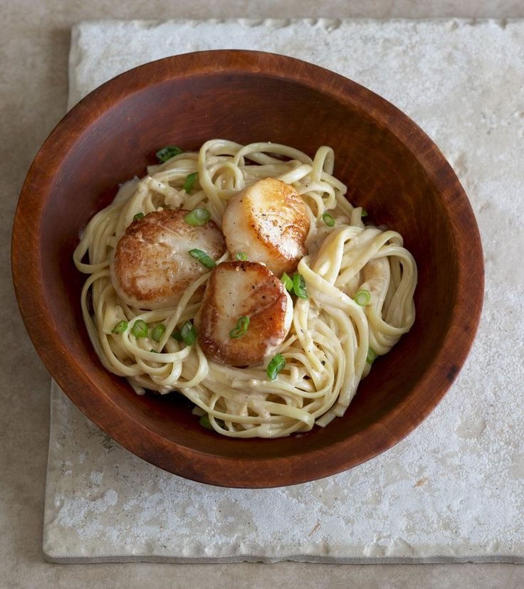 ... creamy lemon sauce. Topped with seared scallops, green onion, and