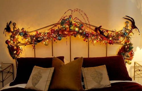 Headboard is decorated with christmas and mardi gras ornaments