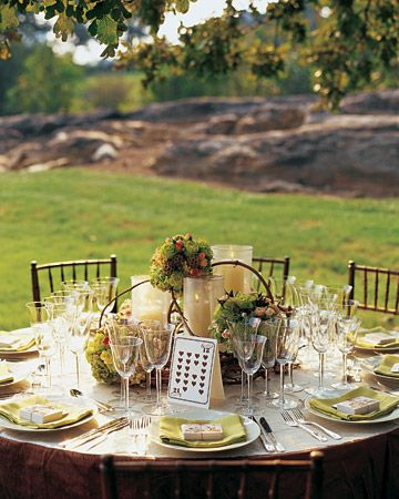 Fall-colored flowers complement a green, cream, and brown color scheme