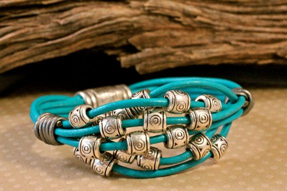 Summer bright blue, turquoise leather bracelet. 6 Strands of leather with drifting silver bali beads gathered together with leather coils. MEMBER - Amy Fine
