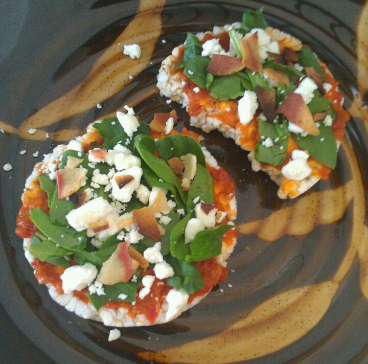 Rice cakes, roasted red pepper spread, spinach leaves, feta cheese ...