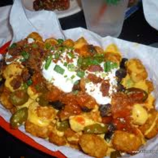 Super Tater Tot Nachos! Layer fried or baked tater tots, nacho cheese ...
