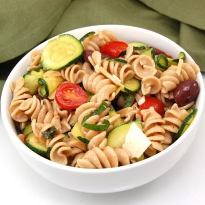 Whole wheat pasta salad with parmesan cheese, almonds, tomatoes ...