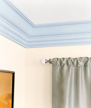 If white crown moldings are too classic for your tastes, consider painting it a color to brighten up the room.