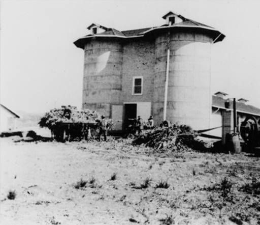 Silos at Brant Ranch, Woodland Hills (formerly Girard), located on the mountain south of Chalk Hill visible in background, 1913. Calabasas Historical Society. San Fernando Valley History Digital Library.