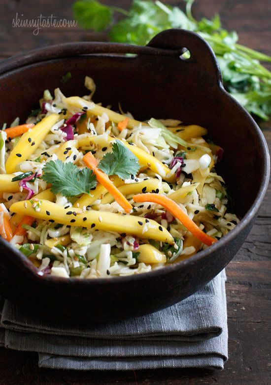 Asian Cabbage Mango Slaw - Light, fresh and crisp slaw made with shredded cabbage, carrots, lime juice, rice vinegar and a slightly under-ripe mango topped with sesame seeds. A perfect side to fish, pork and even burgers. 2points+ #glutenfree