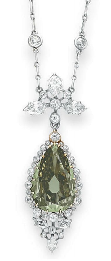 A BELLE EPOQUE COLORED DIAMOND PENDANT NECKLACE   Set with a pear-shaped fancy dark gray-yellowish green diamond, weighing approximately 5.84 carats, to the collet-set old European and marquise-cut diamond surround and foliate link, from a platinum fine link neckchain, spaced by collet-set old European-cut diamonds, mounted in gold and platinum, circa 1910, 17 ins.