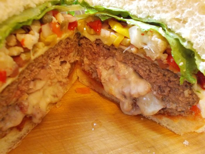 cheese are the ingredients used to stuff the Muffaletta Burger ...