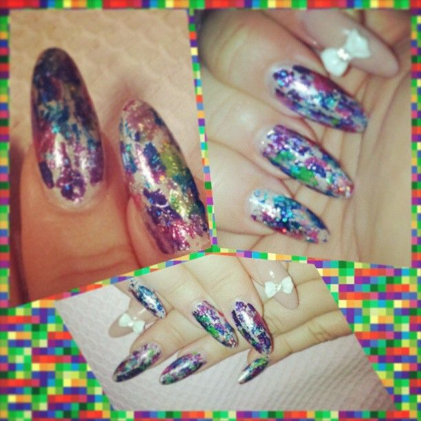 Silver Shellac nails with Tie Dye foil overlay, and bow features. From