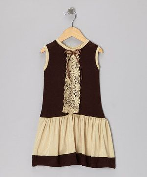 Embellished with a bookmark-like strip of lace, this frock adds a bit of fanciful fun to playtime. Made from soft knit fabric and boasting an over-the-head silhouette, it keeps sweeties cool and comfy.