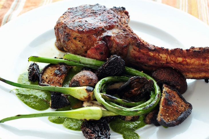 tomahawk chops with grilled assorted mushrooms and garlic scapes. This ...