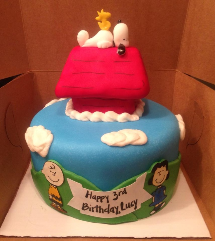Charlie Brown, Snoopy, Woodstock, and Lucy 2 layered cake with Snoopy doghouse topper.  Characters are cut using the Silhouette Cameo and painted with gel food color diluted with vodka (so it evaporates quickly).  Doghouse is make from rice krispie treat covered with fondant.