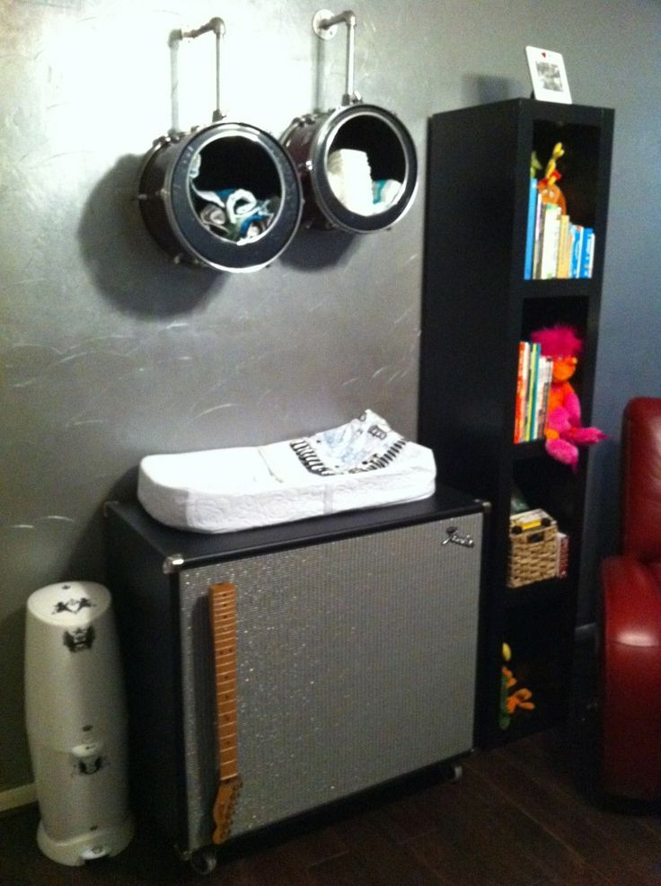 This rock 'n roll themed nursery features drum shelves and an amp changing table. Rock on! #nursery #rocknroll