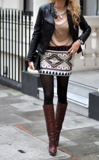 Tribal print skirt with tights, tall brown boots, and a black leather jacket