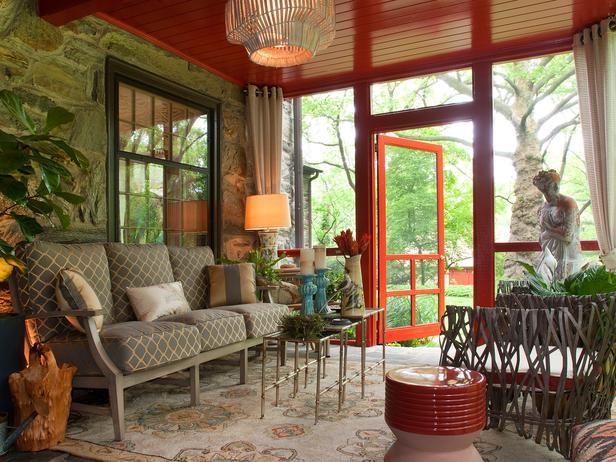 To coordinate with the classy dining space adjacent to the sun room, designer Deborah Bettcher got rid of this sun room's out-of-date wicker furnishings and kicked up the style by adding bright colors.