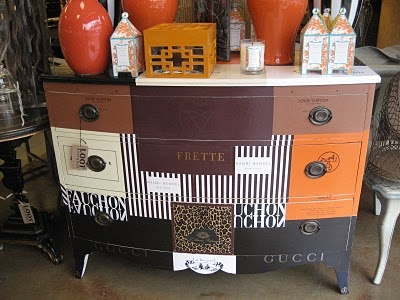 Decoupage a dresser with shopping bags.  from the store Loot, near San Francisco.  LA DOLFINA: Loot