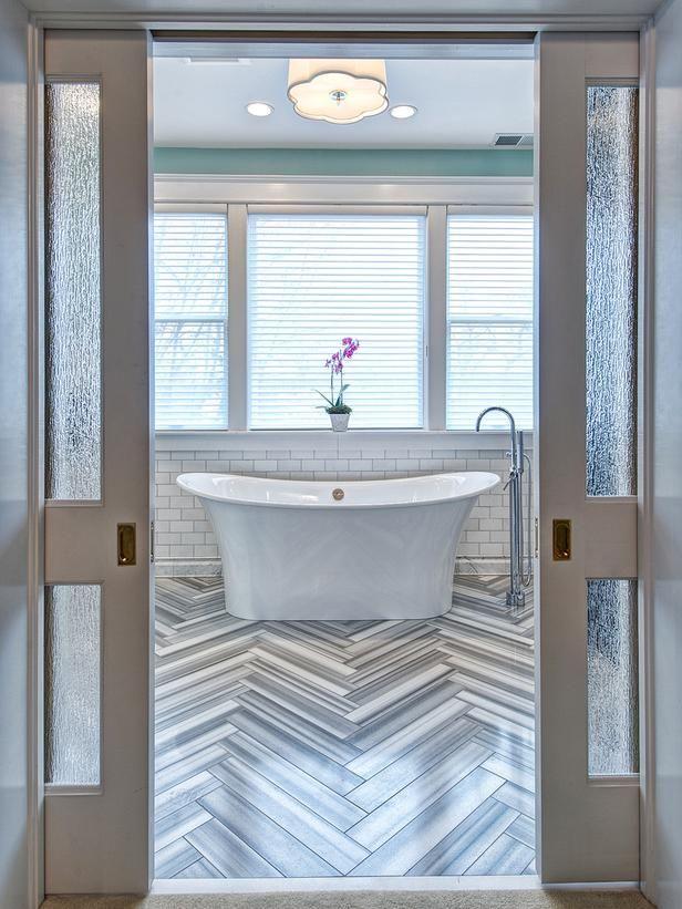 elegant eclectic master bathroom with pocket doors