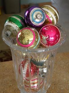 Vase full of vintage striped ornaments