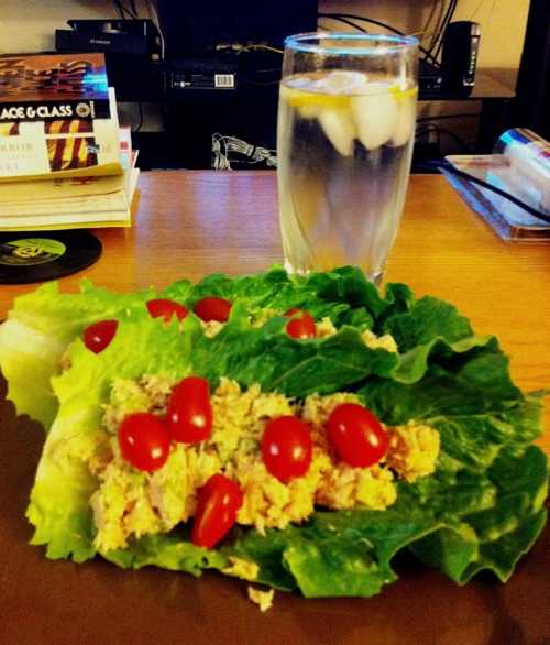 tuna salad and romaine lettuce with cherry tomatoes wraps
